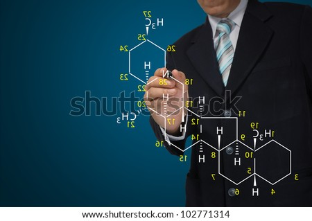 Male Teacher write science formula on blue background - stock photo