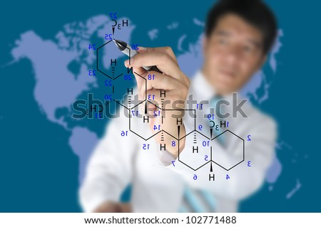 Male Teacher write science formula on blue background with world map - stock photo