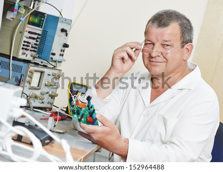 male technicial engineer scientist with microchip plate at test laboratory factory - stock photo