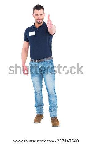 Male technician gesturing thumbs up on white background