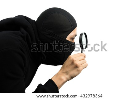 Male thief use magnifying glass for spy isolated on white background with clipping path  - stock photo