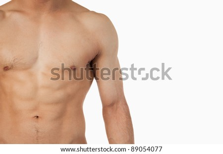 Male toned abs against a white background