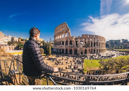 Male tourist enjyoing the view at the Colosseum in Rome, Italy