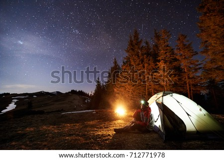 sitting next to the campfire underneath the stars One of the most enjoyable parts of a camping trip is sitting under the stars and enjoying a crackling bonfire, staring into the flames or roasting marshmallows you can recreate this experience in.