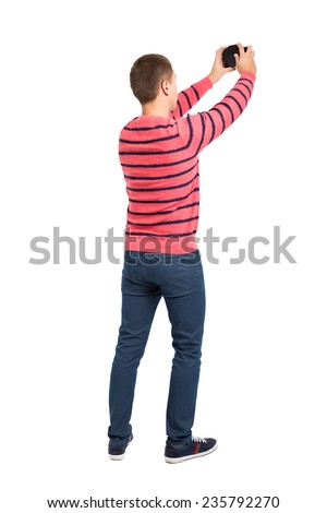 Male tourist taking a photo with camera isolated on white background, rear view