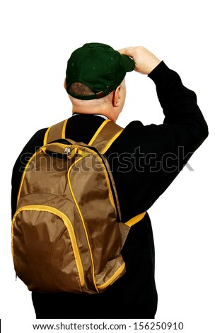 male tourist with a backpack and a baseball cap looking upwards with his head, white background.