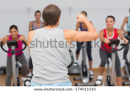 Male trainer and fitness class at class in gym