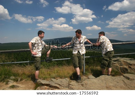 Male triplets in front of mount Brocken, seen from Mt. Achtermann (Harz, Germany)