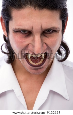 male vampire close up on white background - stock photo