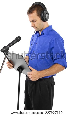 male voice over artist or singer on a microsphone wearing a blue shirt on a white background - stock photo