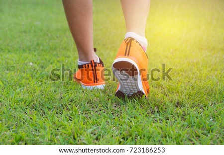 Male walking at the morning for warm up body for jogging and exercise.