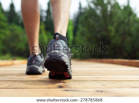 Male walking outdoors.  - stock photo