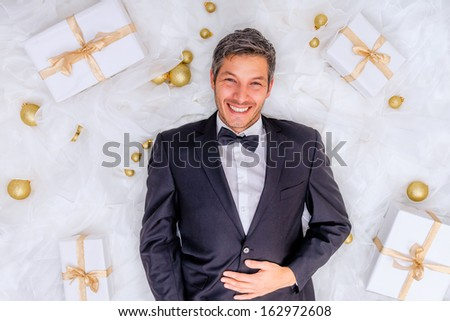 male with a lot of online shopping gifts - stock photo