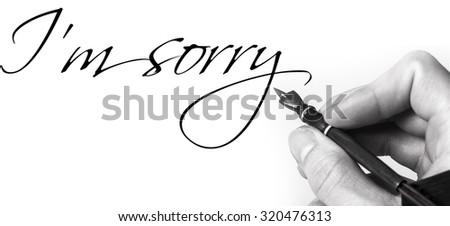 male feather pen writing im sorryの写真素材 ロイヤリティフリー