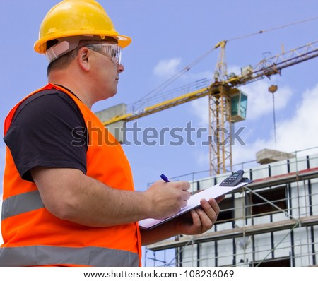 Male worker at Construction site with plan