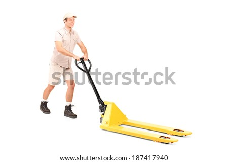 Male worker pushing a fork pallet truck isolated on white background - stock photo