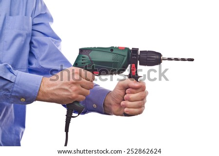Male worker's hand holding electric handy drill. Part of series set of images with DIY tools for home jobs and crafts in hand isolated on white background. - stock photo
