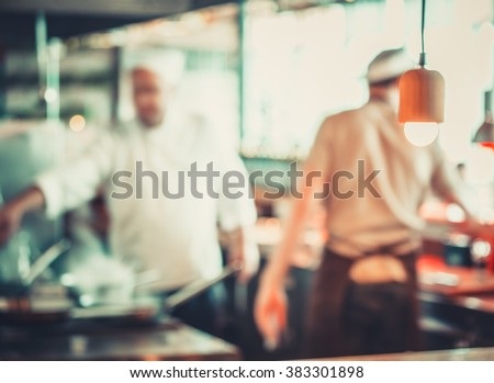 male workers cooking in Turkish restaurant - stock photo