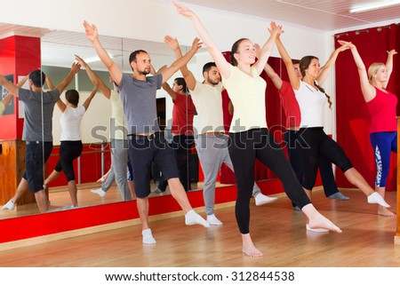 Males and females smiling and dancing contemp dance in studio - stock photo