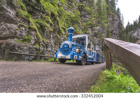 MALGA CIAPELA, ITALY - CIRCA SEPTEMBER 2015: The touristic train in the mountain gorge Serrai di Sottoguda