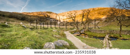 Malham Cove Panorama / Malham Cove in Malhamdale is a popular tourist attraction of the Yorkshire Dales National Park - stock photo