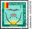 MALI - CIRCA 1964: A stamp printed in Mali shows Mali Flag and Emblems, circa 1964. - stock photo