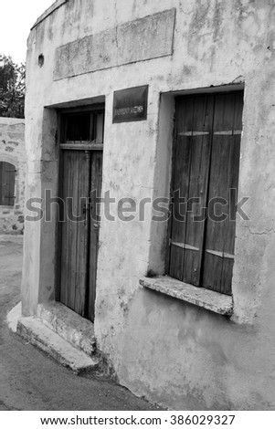 MALIA, GREECE - 11 SEPTEMBER, 2015: Old building in old part of Malia, Crete, Greece. Malia tourist town on the northern coast of Crete. Black and white.