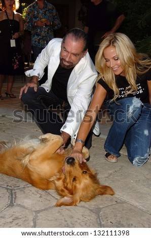"MALIBU, CA - AUGUST 05: John Paul Dejoria and Eloise Dejoria at ""Bow Wow Ciao"" to Benefit Much Love Animal Rescue on August 05, 2006 at John Paul and Eloise Dejoria Estate in Malibu, CA. - stock photo"