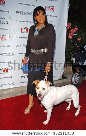 "MALIBU, CA - AUGUST 05: Pam Grier at ""Bow Wow Ciao"" to Benefit Much Love Animal Rescue on August 05, 2006 at John Paul and Eloise Dejoria Estate in Malibu, CA. - stock photo"