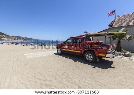MALIBU, CALIFORNIA, USA - August 15, 2015:  Los Angeles County Lifeguard truck on the sand at Topanga State Beach in Santa Monica Bay.   - stock photo