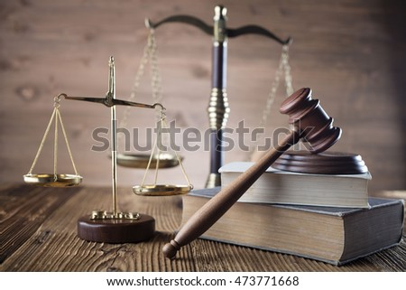 Mallet, legal code and scales of justice. Law concept, studio shots Law theme, hourglass, golden scales of justice, gavel and books on brown background