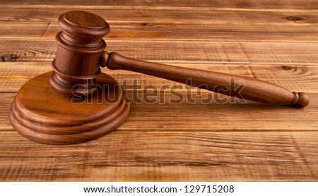 mallet on a wooden table - stock photo