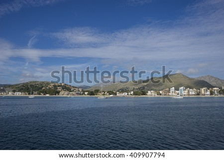 Mallorca beach with stormy sky, seashore without people - stock photo