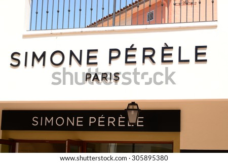 "MALLORCA - JULY 31, 2015: Logo of famous ""Simone Perele""  in Festival Park Outlets village in Mallorca. Simone P���©r���¨le is a brand underwear French created in 1948."