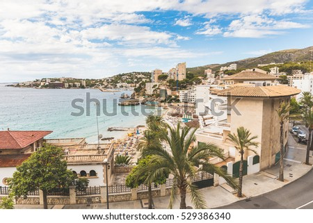 Mallorca, view of Cala Mejor beach. Hotels and seaside of this beautiful beach in Majorca. Summer, tourism and travel concepts.