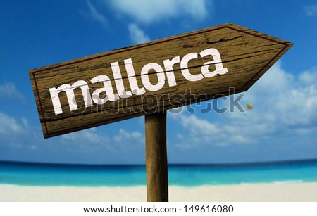 Mallorca wooden sign with a beach on background - stock photo