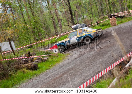 MALLOW, IRELAND - MAY 19: M. Nevin driving Ford Escort at the Jim Walsh Cork Forest Rally on May 19, 2012 in Mallow, Ireland. 4th round of the Valvoline National Forest Rally Championship. - stock photo
