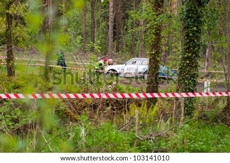 MALLOW, IRELAND - MAY 19: S. Benskin off road on Ford Escort at the Jim Walsh Cork Forest Rally on May 19, 2012 in Mallow, Ireland. 4th round of the Valvoline National Forest Rally Championship. - stock photo