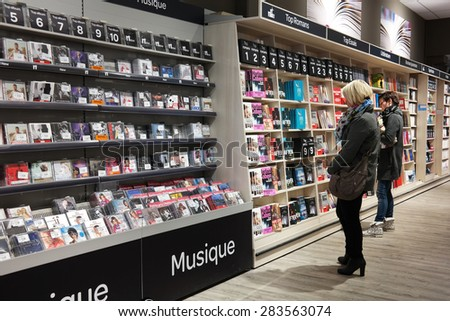 MALMEDY, BELGIUM - MAY 2015: Customers in the media section in a Carrefour Hypermarket - stock photo