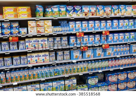 MALMEDY, BELGIUM - MAY 7, 2015: Shelves filled with commercial baby food in a Carrefour hypermarket. Traders massively buying baby food in Europe, to sell on the Chinese black market. - stock photo