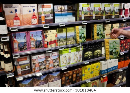 MALMEDY, BELGIUM - MAY 7:Shelves with Cardboard wine cartons of 3 liter in a Carrefour Hypermarket. Photo taken on May 7, 2015 in Malmedy, Belgium - stock photo