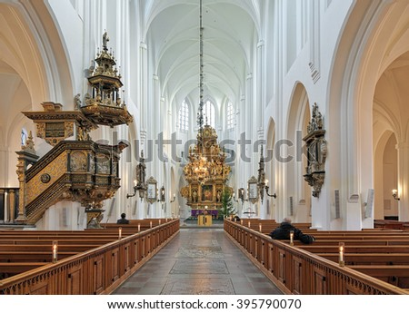MALMO, SWEDEN - DECEMBER 13, 2015: Interior of St. Peter's Church. Construction of the church started in 1313. In 1528-1541 the priest of the church was Claus Mortensen, a Danish protestant reformer. - stock photo