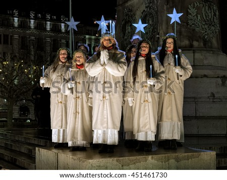 MALMO, SWEDEN - DECEMBER 13, 2015: Lucia and her entourage sing a song on the Main square during the celebration of St. Lucy's Day. Malmo's Lucia 2015 was elected Matilda Strom, a service dog handler. - stock photo