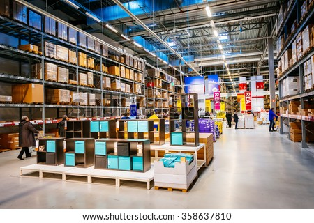 MALMO, SWEDEN - JANUARY 2, 2015: Interior of large IKEA storehouse with a wide range of products in Malmo, Sweden. Ikea was founded in Sweden in 1943, Ikea is the world's largest furniture retailer. - stock photo