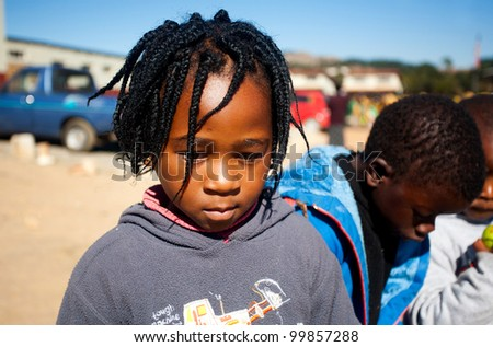 MALOLOTJA, SWAZILAND-JULY 31: Unidentified orphan schoolboy on July 31, 2008 in Malolotja Government School, Malolotja, Swaziland. Close to 10% of Swaziland's population are orphans, due to HIV/AIDS. - stock photo