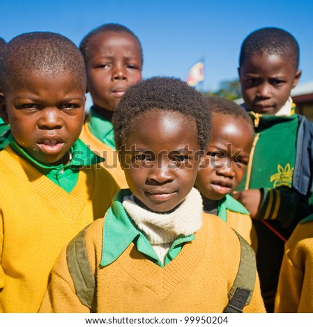 MALOLOTJA, SWAZILAND-JULY 31: Unidentified orphan schoolboys on July 31, 2008 in Malolotja Government School, Malolotja, Swaziland. Close to 10% of Swazilands population are orphans, due to HIV/AIDS. - stock photo