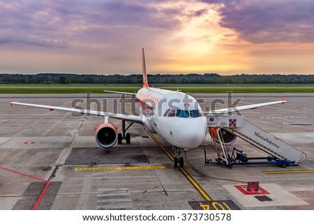 MALPENSA, ITALY - SEPTEMBER 22, 2015: Easyjet airplane on parking in Malpensa - largest airport for Milan metropolitan area, serves 15 million inhabitants, has 2 terminals and runways. - stock photo