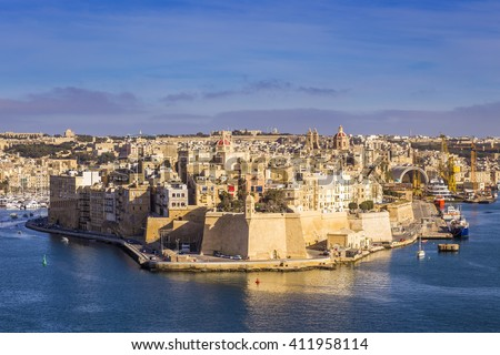 Malta - Aerial view of the ancient walls of Senglea and Gardjola Gardens shot from Valletta on a sunny day with blue sky - stock photo