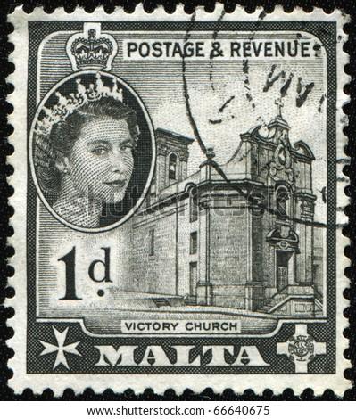 MALTA - CIRCA 1956: A stamp printed in Malta shows Queen Elizabeth II and Victory Church, circa 1956 - stock photo
