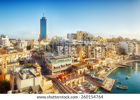 MALTA - JANUARY 20 2015: View to Portomaso tower over Spinola bay shore with famous touristic restaurants at St Julian, Malta - stock photo